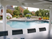 View from the interior is a vista across the pool to the house.