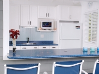 """""""Atlantis"""" Corian was used for the counters throughout the pool house."""