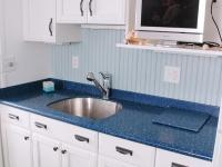 The kitchenette provides plenty of storage cabinets.