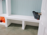 A bench sits oposite the bathroom.