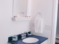 The blue and white theme carries over into the bathroom.