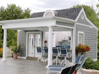 New England style with gray shingles and white trim.