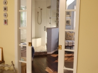 Master Bath After, view through new French pocket doors