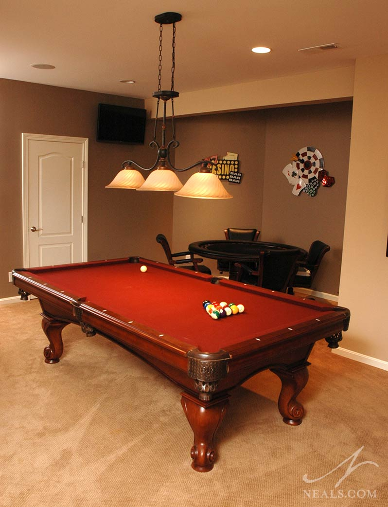 AFTER: The space was reinvented as the new home for a billiard table. The mirrors were removed and the angled nook was equipped with a card table to make this the ultimate party zone. | Neal's Design Remodel Summer Update 2014