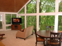 Sunroom interior with wooded view