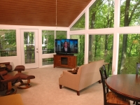Sunroom interior with vaulted ceiling