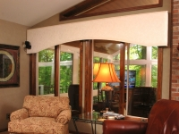 View to interior of sunroom from shared wall in home