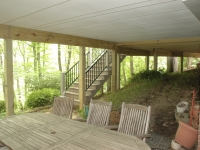 Patio below sunroom with remodeled stairs